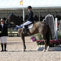 Lauren Tyree is presented with a $1,000 bonus winning the High Junior Jumper Classic at the WEF