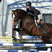 © ESI Photography. Hunter Holloway and Blige on course in the HITS Equitation Championship