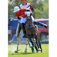 Gonzalito Pieres keeps possession of the ball despite pressure from Coca-Cola's Julio Arellano