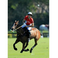 Nico Pieres keeps eye on the ball as he goes for it mid-air