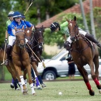 Cipi Echezarreta of Polo School Green goes for the ball while trying to avoid the hook from Polo School Blue's Riley Ganzi