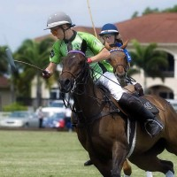 Polo School Green's Grant Ganzi goes for the ball with his sister Riley Ganzi of Polo School Blue in hot pursuit