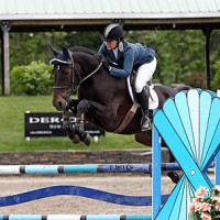 ©ESI Photography. Alissa Kinsey and Grisset jump to a win in the $10,000 M&S Child/Adult Jumper Classic
