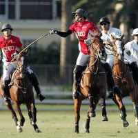 Nic Roldan of Audi tries to keep the ball in play with Audi teammate Lucas Lalor backing him up and Piaget's Brandon Phillips and Juan Bollini charging on defense