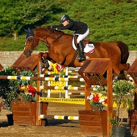 Liza Finsness and her own Ormsby Hill tackle the $35,000 Adequan Grand Prix course designed by legendary Steve Stephens