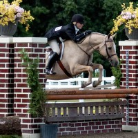 Champlain Sovereign and Paige Parker sail over an oxer in last year's $25,000 Pony Hunter Classic