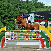 ©ESI Photography. Todd Minikus and UDonnay Z jump to a win in the $10,000 Brook Ledge Open Welcome