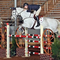 Tim Maddrix sails over an oxer Saturday night with KT Cher