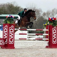 Cookie Monster and Ryan Genn clear the CWD jump last Sunday at the Harrison County Fairgrounds. Photo by MH Hamm