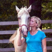 Bridget Kroger and her horse Dusty of Wounder Warrior's Equestrian Program