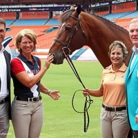 Margie Engle and Dolphins Hall of Famer Bob Griese, right, with Jimmy Torano and Olympic Gold medalist Beezie Madden at Sun Life Stadium