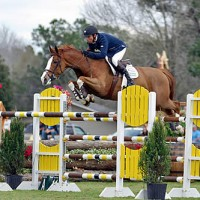 Bugatti and Genn fly over an oxer on the best turf grand prix field in the country. Flashpoint Photography.