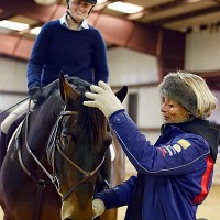 Mary King works with clinic attendee Erin Nolan and Highland Casino