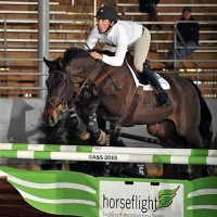 Andy Kocher and Land Rebel sail over the HorseFlight oxer on their way to the win Friday.