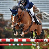 British show jumping superstar Gemma Paternoster and Figarro D sail over a jump in the Olympic Stadium