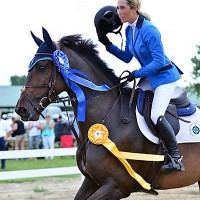 Paternoster takes 'Dolly' on her victory gallop after winning the $35,000 Devoucoux Grand Prix